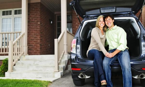 Home and Auto Insurance-couple sitting in the back of car