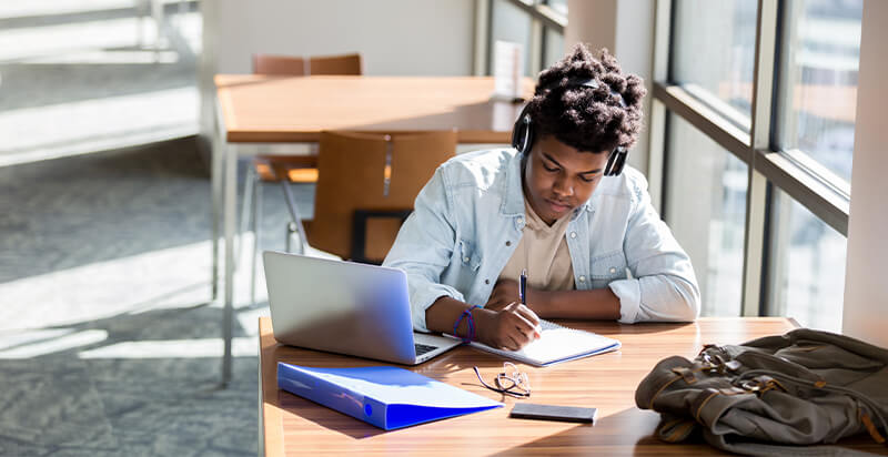 Student Loans-young man studying